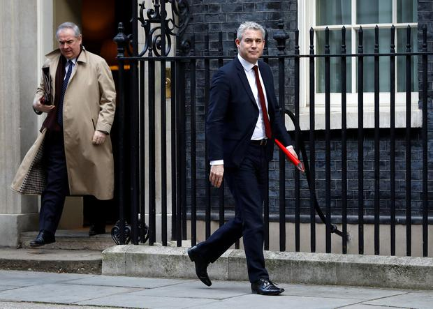Guarantees: Britain's attorney general Geoffrey Cox and Brexit Secretary Stephen Barclay leaving Downing Street yesterday. Photo: Reuters