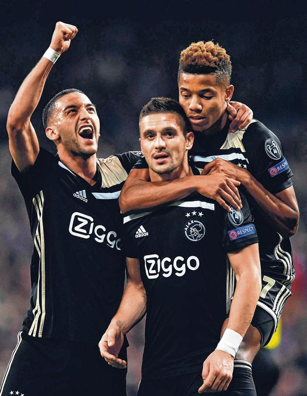 Ajax's Dusan Tadic (C) celebrates with David Neres (R) and Hakim Ziyech after scoring against Real Madrid. Photo: Gabriel Bouys/AFP/Getty Images