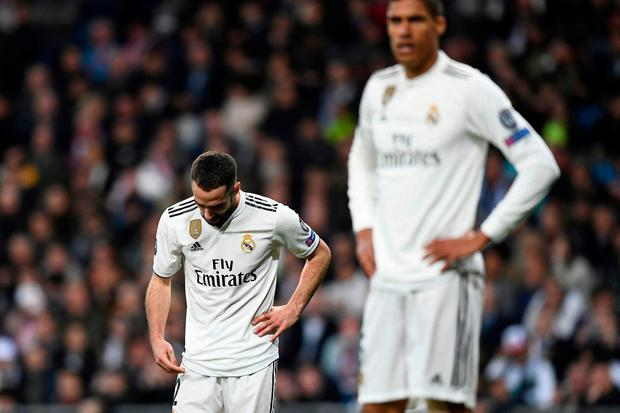 Real Madrid's Spanish defender Dani Carvajal reacts during the UEFA Champions League round of 16 second leg football match between Real Madrid CF and Ajax at the Santiago Bernabeu stadium in Madrid on March 5, 2019. (Photo by GABRIEL BOUYS / AFP)GABRIEL BOUYS/AFP/Getty Images
