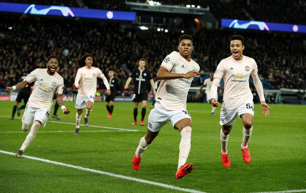 Soccer Football - Champions League - Round of 16 Second Leg - Paris St Germain v Manchester United - Parc des Princes, Paris, France - March 6, 2019 Manchester United's Marcus Rashford celebrates scoring their third goal with Mason Greenwood and team mates Action Images via Reuters/John Sibley
