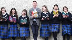 Readers: Ryan Tubridy with students from St Raphaela's Secondary School, Stillorgan, Dublin, at the launch Children's Books Ireland school libraries campaign. Photo: Photocall Ireland