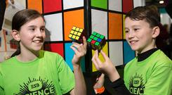 Puzzle: Anna Johnston and Aaron Flanagan, from Mullingar, tried to develop an algorithm to solve the Rubik's Cube. Photo: Shane O'Neill