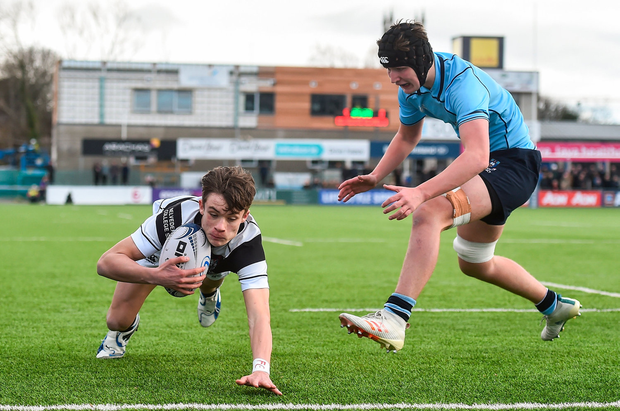 6 March 2019; Dylan O'Grady of Belvedere College scores his side's second try despite the efforts of Stephen Woods of St Michael's College during the Bank of Ireland Schools Senior Cup semi-final match between Belvedere College and St Michael's College at Energia Park in Donnybrook, Dublin. Photo by Piaras Ó Mídheach/Sportsfile