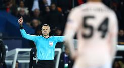 The match referee checks the VAR system and awards a penalty in favor of Manchester United during the UEFA Champions League Round of 16 Second Leg match between Paris Saint-Germain and Manchester United at Parc des Princes. (Photo by Julian Finney/Getty Images)