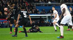 Prenel Kimpembe of PSG handles the ball inside the area from Diogo Dalot of Manchester United shot leading to a penalty via VAR during the UEFA Champions League Round of 16 Second Leg match between Paris Saint-Germain and Manchester United at Parc des Princes. (Photo by Julian Finney/Getty Images)