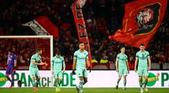 Pierre-Emerick Aubameyang of Arsenal and his team-mates show their dejection after conceding a second goal during the UEFA Europa League Round of 16 First Leg match between Stade Rennais and Arsenal at Roazhon Park. (Photo by Julian Finney/Getty Images)