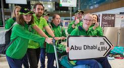 Fergal Gregory holds a sign with fellow Olympians and coaches. Photo: Mark Condren