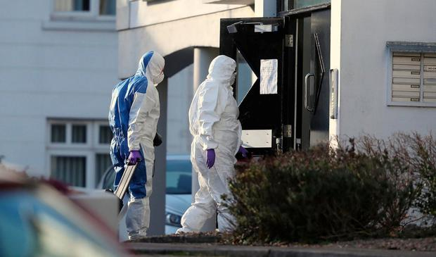 Murder probe: Police forensic officers enter the apartment complex at Glin Ree Court in Newry, Co Down. Photo: Niall Carson/PA Wire