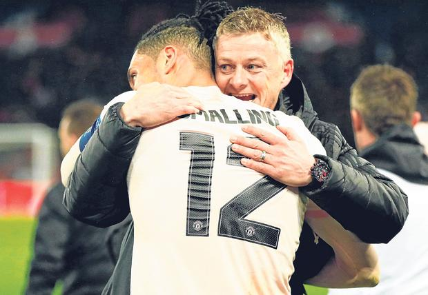Red set: Ole Gunnar Solskjaer embraces Chris Smalling after Wednesday's win in Paris as the Manchester United players endorse his permanent appointment. Photo: John Sibley
