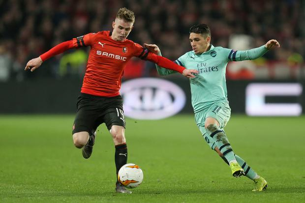 Rennes' Benjamin Bourigeaud, left, and Arsenal's Lucas Torreira fight for the ball. Photo: David Vincent/AP