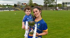 Lorna Fusciardi of Wicklow and her daughter Harley with the cup after the Lidl Ladies Football National League Division 4 Final match between Louth and Wicklow at St Brendan's Park