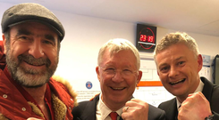 Manchester United caretaker manager Ole Gunnar Solskjaer celebrates the Champions League win over PSG with Eric Cantona and Alex Ferguson