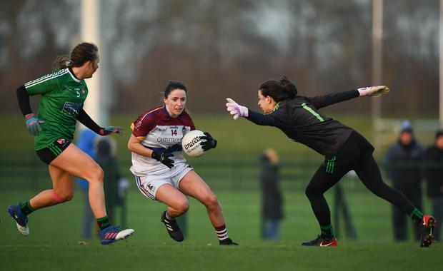 8 March 2019; Eimear Scally of UL gets past QUB goalkeeper Julie Curran on her way to scoring her side's fourth goal during the Gourmet Food Parlour O'Connor Cup Semi-Final match between University of Limerick and Queens University Belfast at the GAA Centre of Excellence in Abbotstown, Dublin. Photo by David Fitzgerald/Sportsfile