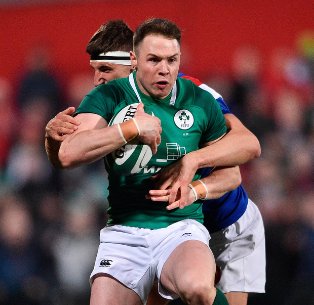 Sean French of Ireland is tackled by France's Gauthier Maravat. Photo: Sportsfile