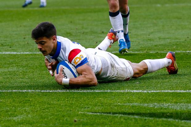 The French number 10 Romain Ntamack scores a try against Scotland last month. Photo: Getty