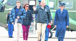 Alabama bound: President Donald Trump and first lady Melania Trump and their son Barron Trump, walk to board Air Force One, en route to Lee County, where tornadoes killed 23 people. (AP Photo/Carolyn Kaster)