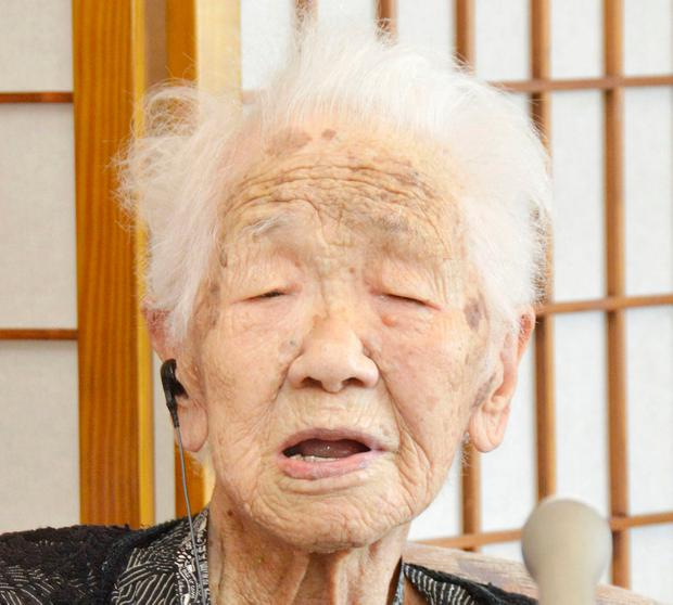 In this July 27, 2018, photo, Japan's oldest living female Kane Tanaka speaks in Fukuoka, southwestern Japan. The 116-year-old Japanese woman who loves playing the board game Othello is being honored as the worldÄôs oldest living person by Guinness World Records on Saturday, March 9, 2019. (Kyodo News via AP)