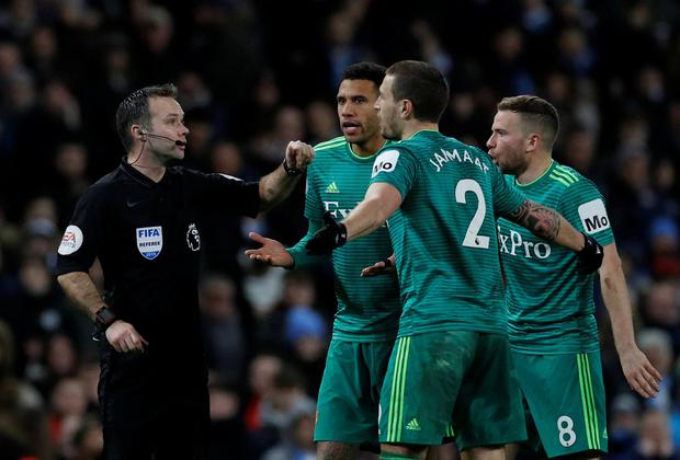 Soccer Football - Premier League - Manchester City v Watford - Etihad Stadium, Manchester, Britain - March 9, 2019 Watford players protest with referee Paul Tierney after Manchester City's Raheem Sterling scores their first goal. REUTERS/Phil Noble