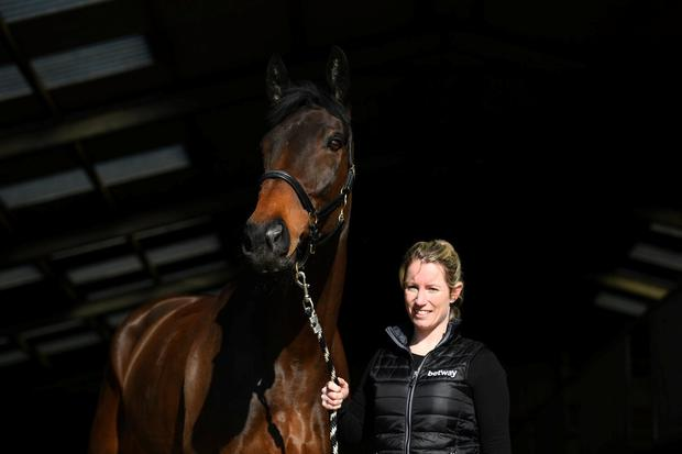 Trainer Kayley Woollacott poses with Lalor. Photo: Harry Trump/Getty Images