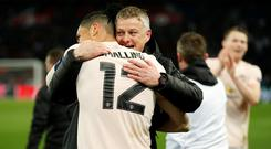 Manchester United interim manager Ole Gunnar Solskjaer and defender Chris Smalling. Photo: John Sibley/Action Images via Reuters