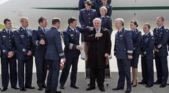 Lisa Smith (37), seen third from the right, who served in the Irish Air Corps pictured with the then Taoiseach Bertie Ahern whom she served while working on the Government jet. Picture: Collins