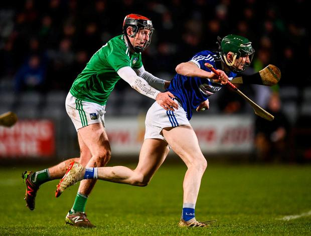 Laois' Aaron Dunphy in action against Limerick's David Dempsey. Photo: Stephen McCarthy/Sportsfile