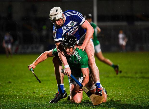 Limerick's Darragh ODonovan in action against Laois' Ryan Mullaney. Photo: Stephen McCarthy/Sportsfile