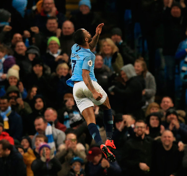 Raheem Sterling celebrates after scoring his, and Manchester City's, third goal against Watford yesterday. Photo: Lindsey Parnaby
