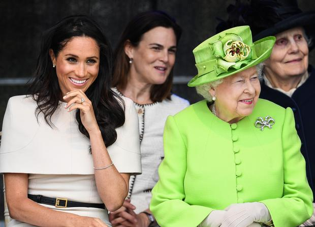CHESTER, ENGLAND - JUNE 14: Queen Elizabeth II sits with Meghan, Duchess of Sussex accompanied by Samantha Cohen (Back, C) during a ceremony to open the new Mersey Gateway Bridge on June 14, 2018 in the town of Widnes in Halton, Cheshire, England. Meghan Markle married Prince Harry last month to become The Duchess of Sussex and this is her first engagement with the Queen. During the visit the pair will open a road bridge in Widnes and visit The Storyhouse and Town Hall in Chester. (Photo by Jeff J Mitchell/Getty Images)