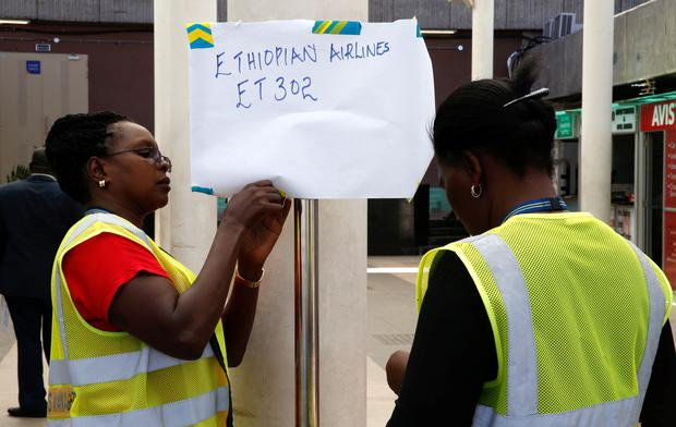 Kenya Airports Authority (KAA) workers hang an information notice of Ethiopian Airlines Flight ET 302, at the Jomo Kenyatta International Airport (JKIA) in Nairobi, Kenya March 10, 2019. REUTERS/Baz Ratner