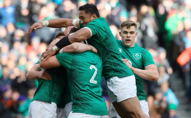 Ireland's Johnny Sexton (obscured) celebrates with team-mates after scoring a try during the Guinness Six Nations match at the Aviva Stadium, Dublin.