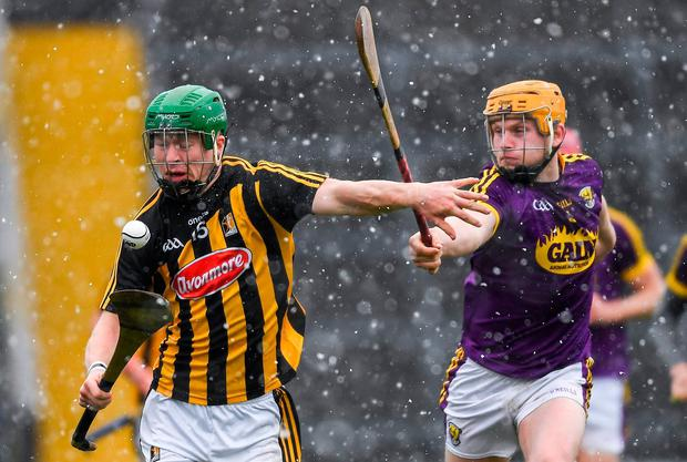 Kilkenny's Martin Keoghan tries to get away from Kevin Foley. Photo: Ray McManus/Sportsfile