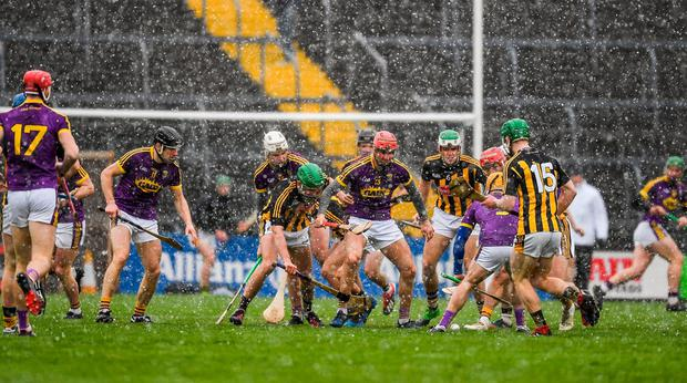 Players from both sides battle for possession. Photo: Ray McManus/Sportsfile