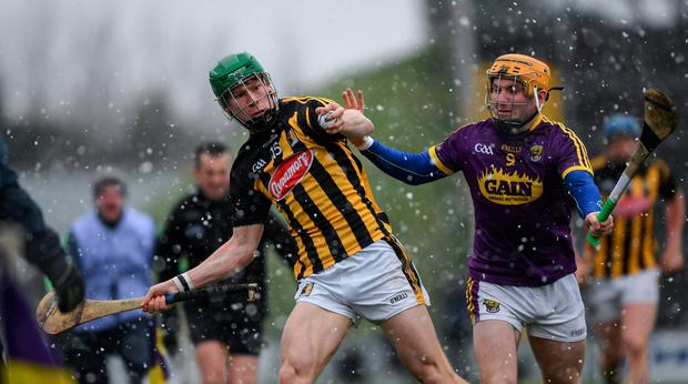 Martin Keoghan is closed down by Wexford's Kevin Foley. Photo: Ray McManus/Sportsfile