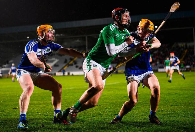 Limerick's David Dempsey tries to break through a challenge from Padraig Delaney, left, and Mark Kavanagh. Photo: Stephen McCarthy/Sportsfile