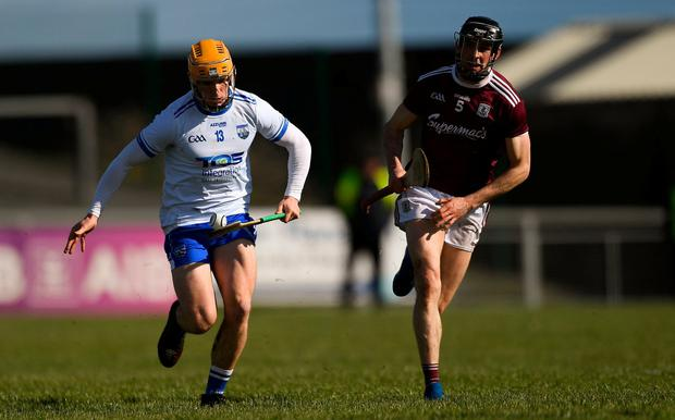 Peter Hogan keeps possession from Galway's Kevin Hussey. Photo: Piaras Ó Mídheach/Sportsfile
