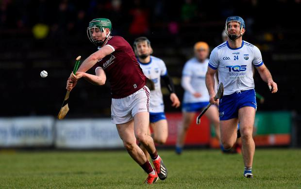 Cathal Mannion of Galway gets away from Waterford's Michael Walsh. Photo: Piaras Ó Mídheach/Sportsfile