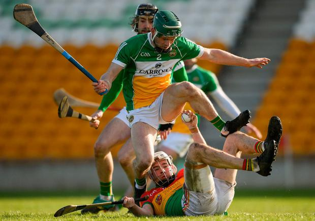 Séamus Murphy keeps possession despite pressure from Offaly's Paddy Rigney. Photo: Eóin Noonan/Sportsfile