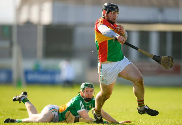 Carlow's John Micheal Nolan leaves behind Damien Egan of Offaly. Photo: Eóin Noonan/Sportsfile