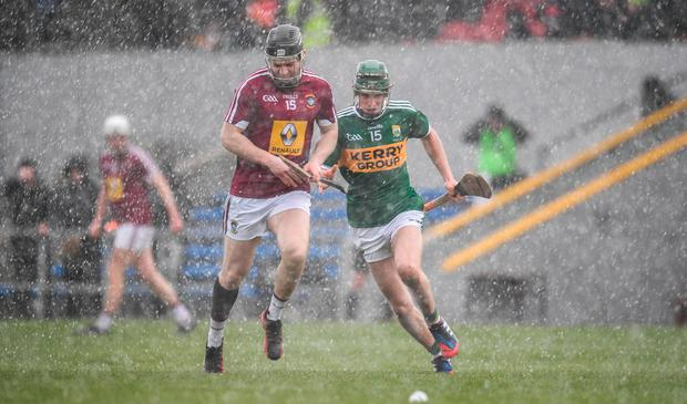 Westmeath's Cormac Boyle and Kerry's Jordan Conway battle the elements and each other. Photo: Sam Barnes/Sportsfile