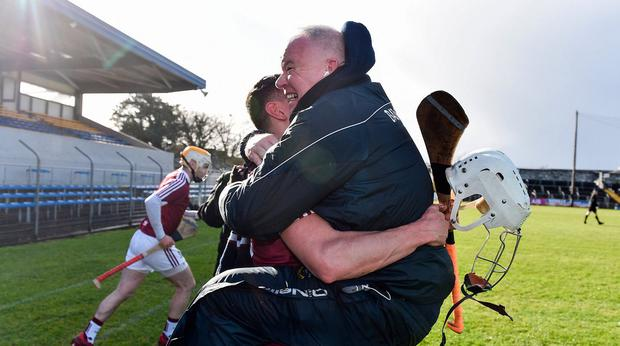 Westmeath manager Joe Quaid, right, and Joey Boyle celebrate at the final whistle. Photo: Sam Barnes/Sportsfile