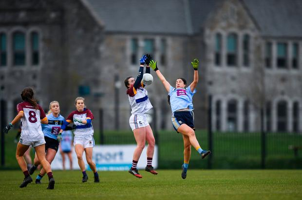 Shauna Kelly of UL battles in the air with UCD's Molly Lamb. Photo: Eóin Noonan/Sportsfile