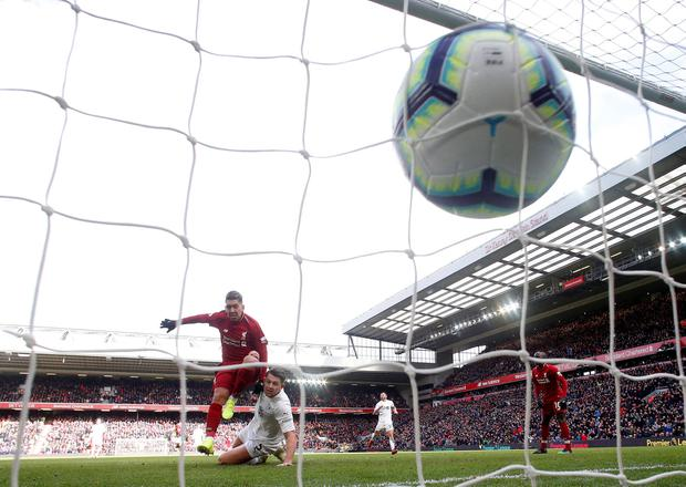 Roberto Firmino's shot hit's the back of the Burnley net. Photo: REUTERS/Andrew Yates