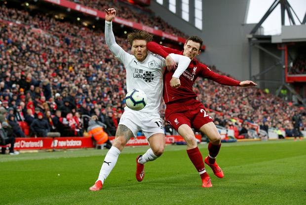 Burnley's Jeff Hendrick tussles with Andy Robertson. Photo: REUTERS/Andrew Yates