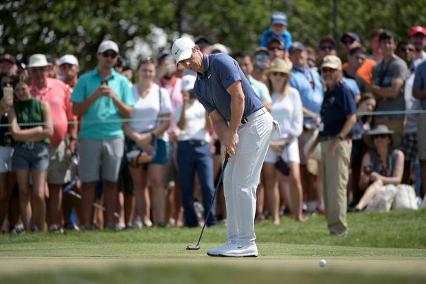 Rory McIlroy makes his putt on the first green during yesterday's final round of the Arnold Palmer Invitational. AP Photo/Phelan M. Ebenhack
