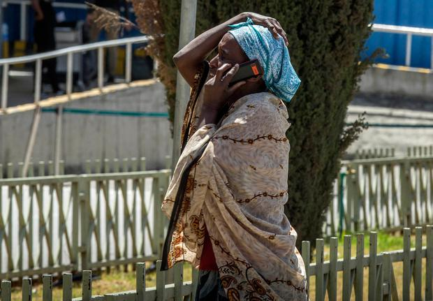 Shock: A woman talks on the phone as she awaits news of family members at Addis Ababa international airport yesterday after the crash. Photo: AP
