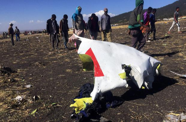 Tragedy: People examine the wreckage of the Ethiopian Airlines plane crash near Addis Ababa, Ethiopia. Photo: Tiksa Negeri/Reuters