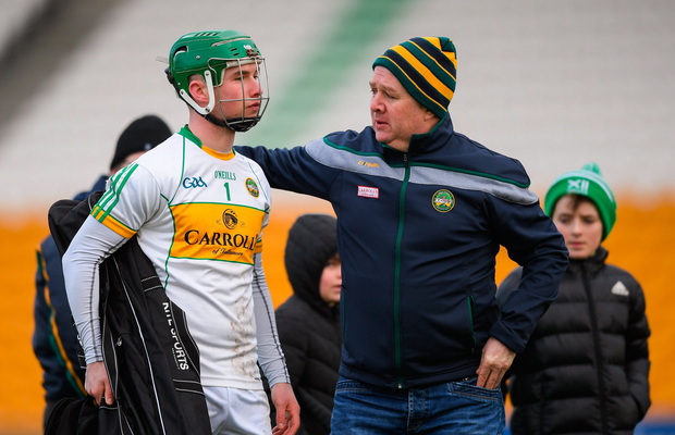 Eoghan Cahill of Offaly is consoled by his father Gary