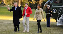 Donald Trump, with First Lady Melania and son Barron at the White House. Photo: Reuters/Mary F. Calvert