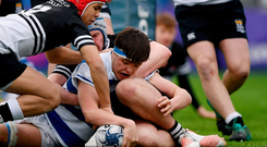 Liam Molony scores a try for Blackrock College despite the efforts of Newbridge College's Lucas Berti Newman. Photo by Harry Murphy/Sportsfile